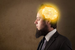 man thinking with glowing brain illustration Stock Images