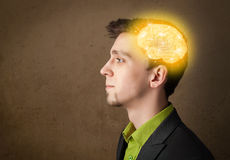 man thinking with glowing brain illustration Royalty Free Stock Image