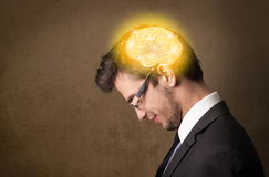 Man thinking with glowing brain illustration Royalty Free Stock Photos
