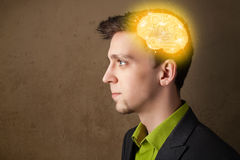 Man thinking with glowing brain illustration. Young man thinking with glowing brain illustration Royalty Free Stock Images