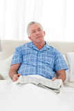 Man thinking in his bed Stock Image
