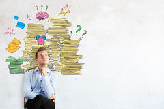 Man thinking about job duties. Thoughtful young businessman on concrete background with drawing of paperwork stacks, alarm clock and other items. Man thinking stock photography