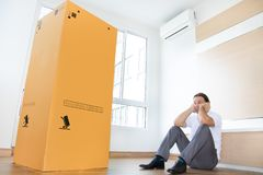 Man is thinking about the large package royalty free stock image