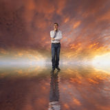 Man thinking about life. Sunset sky and a man reflecting at his life and problems Royalty Free Stock Photography