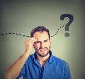Young man thinking looking for a solution. Man thinking looking for a solution royalty free stock photography