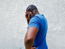 Man thinking and looking worried, headache, holding head in one hand royalty free stock photo