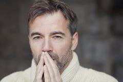 Man Thinking. Mature Man Thinking And Praying Royalty Free Stock Images