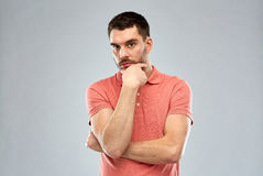 Man thinking over gray background royalty free stock image