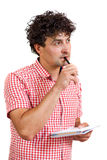 Man thinking with a pencil and notebook Stock Image