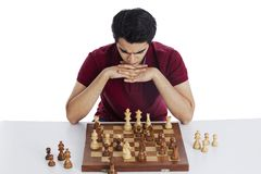 Man thinking while playing chess Royalty Free Stock Photo