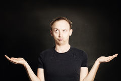 Man Thinking and showing his empty hands. Choice Stock Images