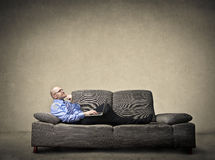 Man thinking on sofa Royalty Free Stock Images