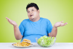 Man thinking to choose salad or burger Stock Photo