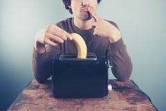 Man thinking about toasting banana Royalty Free Stock Photography