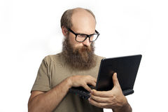 The man thinking and typing Stock Image