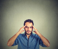 Man thinking very intensely concentrating Stock Photography
