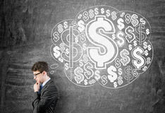 Man thinking about wealth Royalty Free Stock Images