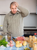 Man thinking what to cook for dinner Royalty Free Stock Photos