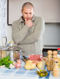 Man thinking what to cook for dinner Royalty Free Stock Photo