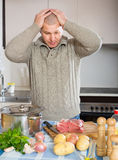 Man thinking what to cook for dinner Stock Photos