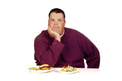 Man thinking what to eat Stock Photos