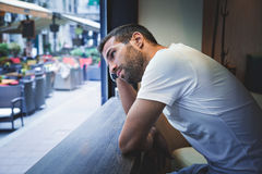 Man thinking by the window. Man thinking by the bar window royalty free stock image