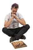 Man thinks on game of chess Stock Images