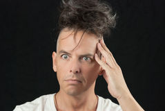 Man Thinks, Looking Off Camera, Hair Piled On Head Royalty Free Stock Photography