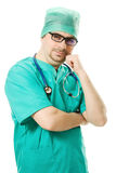 Man thinks the surgeon with a stethoscope Royalty Free Stock Images