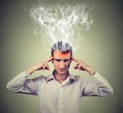 Man thinks very intensely having headache. human face expression Royalty Free Stock Photo