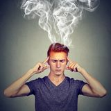 Man thinks very intensely having headache royalty free stock images