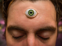 Man Third Eye. Handsome male fortune teller with magic third eye stock photography