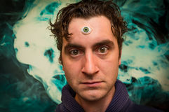 Man Third Eye. Handsome male fortune teller with magic third eye stock images