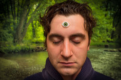 Man Third Eye. Handsome male fortune teller with magic third eye stock photo