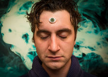 Man Third Eye. Handsome male fortune teller with magic third eye royalty free stock photo
