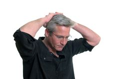Man in Thought. Middle age man in deep thought Royalty Free Stock Photography