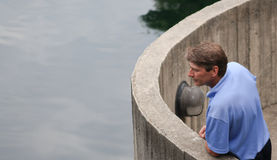 Man in thought. White male in 40's looking over water in thought Royalty Free Stock Photo
