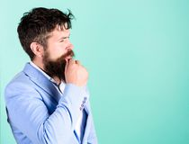 Man thoughtful doubtful face thinking. Have some doubts. Hipster bearded face not sure in something. Doubtful bearded. Men on blue background. Doubtful stock image