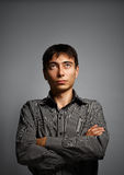 Man in thoughtful pose on grey background Royalty Free Stock Photography