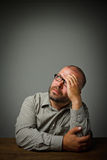 Man in thoughts. Dreamer. Man in thoughts. Sitting in the shadow Stock Photo
