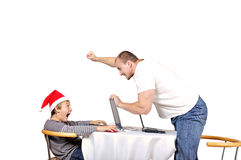 Man threaten child in santa hat Royalty Free Stock Images