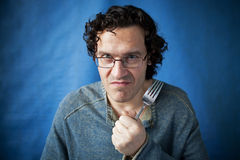 Man threatening species with fork in hand  Stock Image