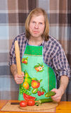 Man threatening with stick and cucumber Royalty Free Stock Photo