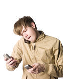 Man with three cellphones. Towards white background Royalty Free Stock Images