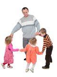 Man with three kids dancing Royalty Free Stock Images