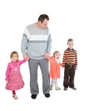 Man with three kids posing Royalty Free Stock Images