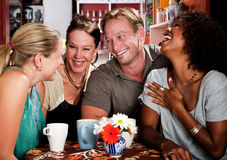 Man with three pretty women in coffee house Royalty Free Stock Photos