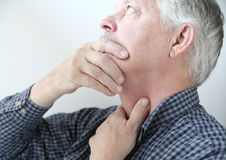 Man with throat or neck problems Stock Image