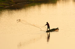 A man throw fishing net in evening Stock Photography
