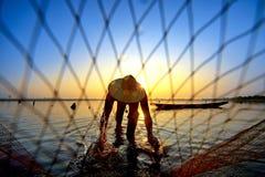 Throw a net. Man throw a net form north of thailand stock photo